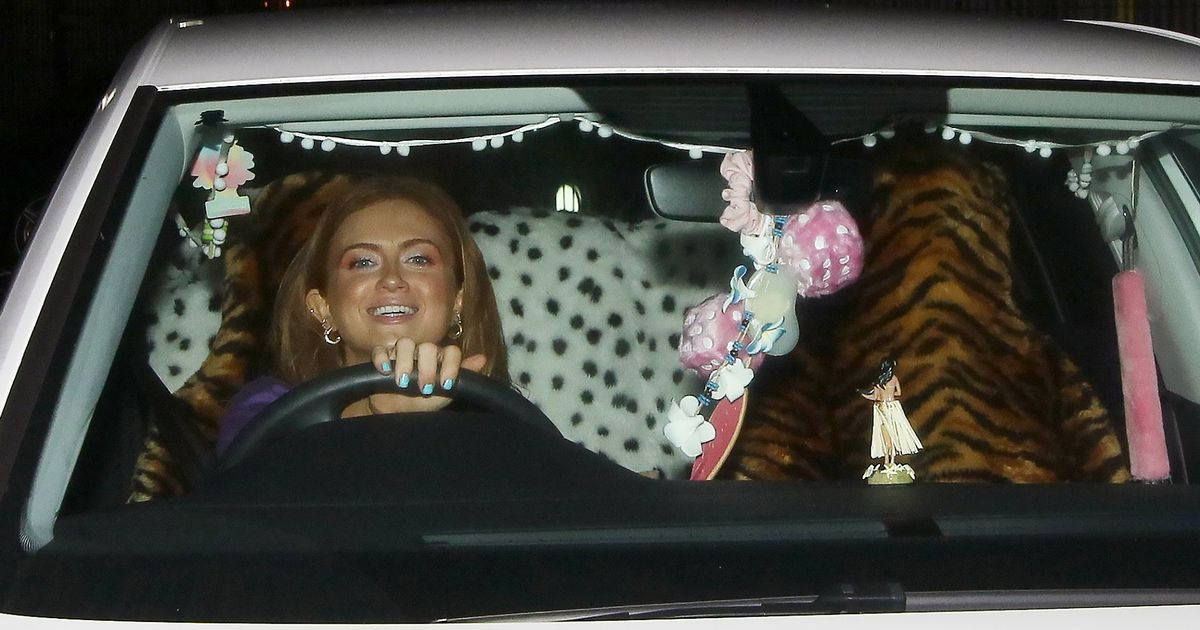 Maisie Smith Flashed A Huge Smile As She Drove Home In Her Car With Leopard Print Seat Covers
